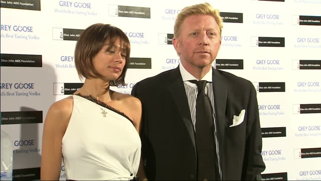 Interior shots of Boris Becker hobbling on crutches with broken leg arriving and posing for photo op with wife Lilly Kerssenberg at Grey Goose Vodka...