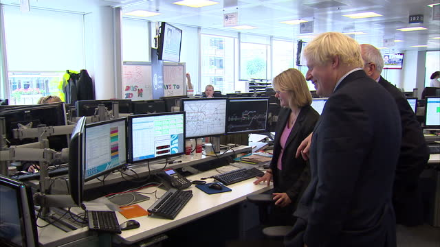 interior shots of boris johnson and justine greening visiting the transport co-ordination centre in south london, and staff members working at desks... - co ordination stock videos & royalty-free footage