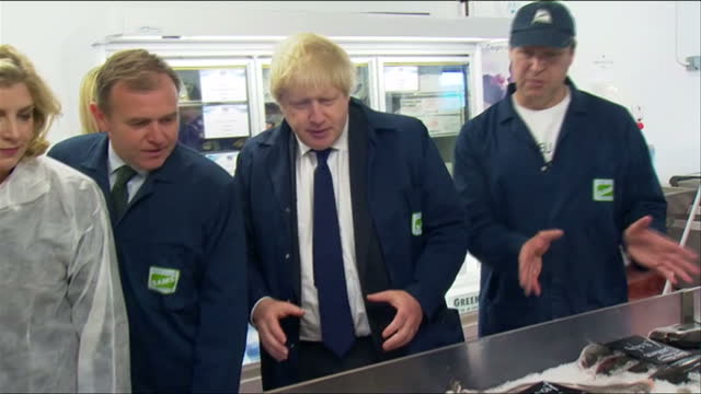 Interior shots of Boris Johnson Leave EU campaigner chatting to fishermen while on a visit to Lowestoft on June 16 2016 in Suffolk England