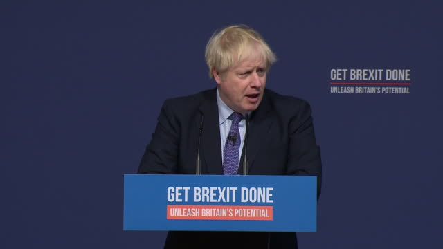 stockvideo's en b-roll-footage met interior shots of boris johnson walking on stage and introducing the conservative party manifesto for the 2019 general election on 24 november 2019... - manifest