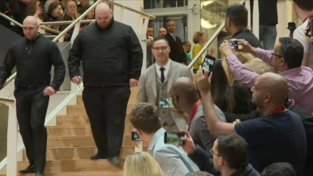 Interior shots of Boxer Joseph Parker walking down steps through crowd and into Boxing press conference on 27th March London England
