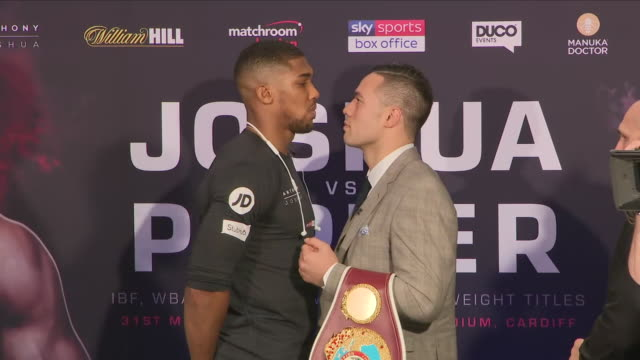 interior shots of boxers joseph parker and anthony joshua stare off for photo op at the heavyweight boxing press conference on 27th march london... - heavyweight stock videos and b-roll footage