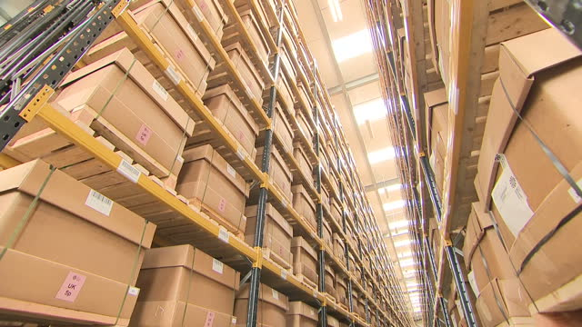 interior shots of boxes containing new pound coins on shelves of warehouse in the royal mint on 10 july 2017 in llantrisant united kingdom - royal mint stock videos & royalty-free footage