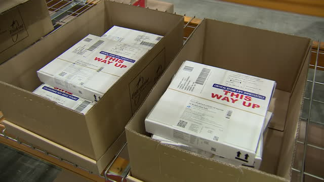 interior shots of boxes of the pfizer covid-19 vaccine on pallets in a distribution centre on 14 december 2020 in birmingham, united kingdom - delivering stock videos & royalty-free footage