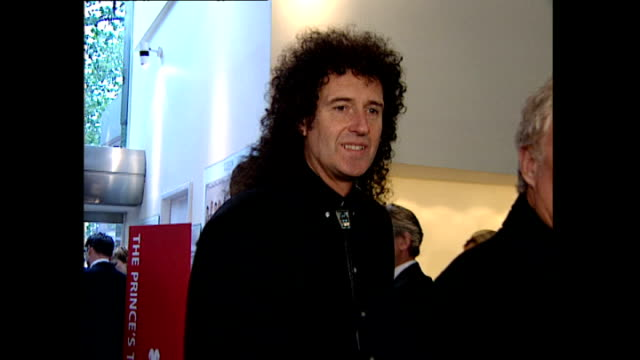 interior shots of brian may arriving at the premiere of maybe baby followed by george michael behind him on may 31, 2000 in london, england. - 後を追う点の映像素材/bロール