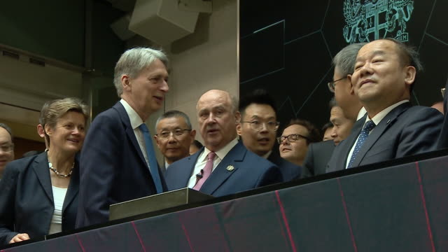 interior shots of british chancellor of the exchequer philip hammond and china's vice premier hu chunhua applauding the opening bell of the london... - chancellor stock videos and b-roll footage