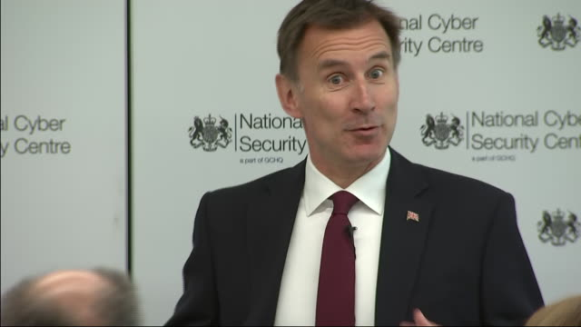 interior shots of british foreign secretary jeremy hunt mp answering a question on theresa may's departure at the national cyber security centre on... - staatsdienst stock-videos und b-roll-filmmaterial