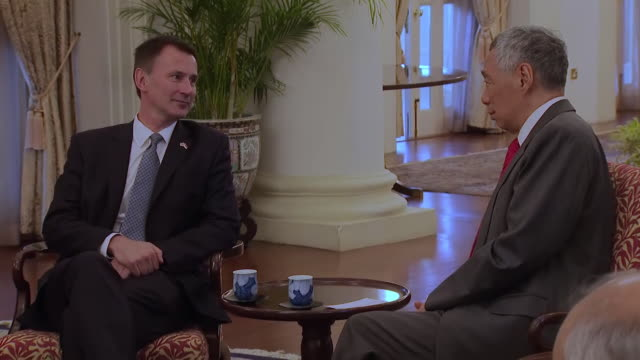 Interior shots of British Foreign Secretary Jeremy Hunt MP meeting the Prime Minister of Singapore Lee Hsien Loong and the Minister for Foreign...
