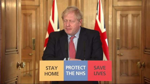 interior shots of british prime minister boris johnson giving a daily press briefing on coronavirus, announcing measures to help self employed... - pressekonferenz stock-videos und b-roll-filmmaterial