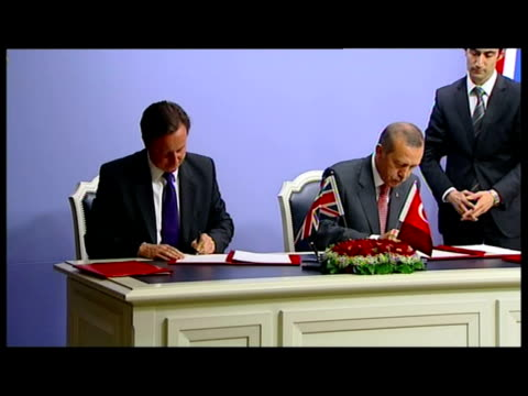 Interior shots of British Prime Minister David Cameron and Turkish Prime Minister Recep Tayyip Erdogan signing a strategic partnership that will...