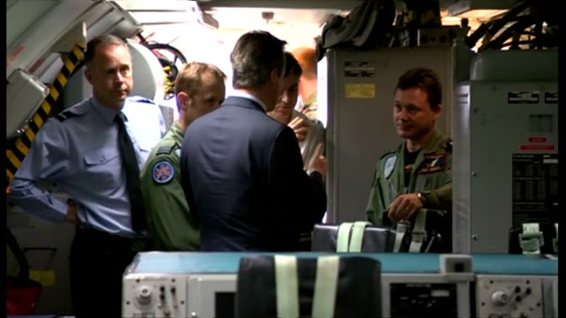 interior shots of british prime minister david cameron being shown round a raf plane looking at military equipment on july 13 2015 in lincoln england - イギリス国防省点の映像素材/bロール