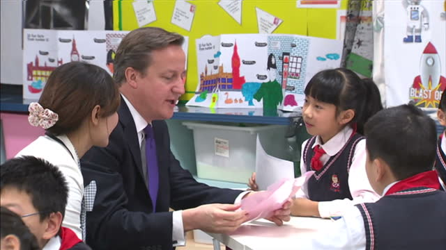 Interior shots of British Prime Minister David Cameron meeting school children in a classroom during a visit to a primary school in Chengdu David...
