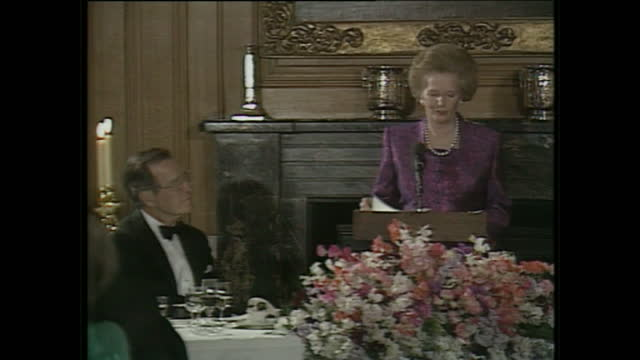 interior shots of british prime minister margaret thatcher and george h w bush sat at the top table margaret thatcher delivers a speech to the room... - bush stock videos & royalty-free footage