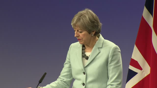 interior shots of british prime minister theresa may and president of the european commission jeanclaude juncker walk out fro press conference on 8th... - europäische kommission stock-videos und b-roll-filmmaterial