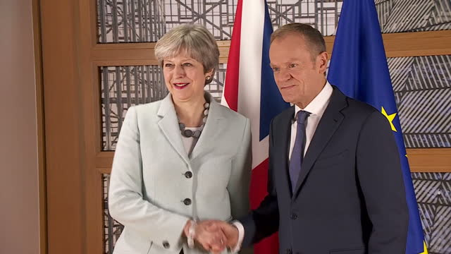 Interior shots of British Prime Minister Theresa May and President of European Council Donald Tusk pose for photo op and shake hands on 8th December...