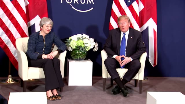 interior shots of British Prime Minister Theresa May and US President Donald Trump speaking to press before talks begin and shake hands on January 25...
