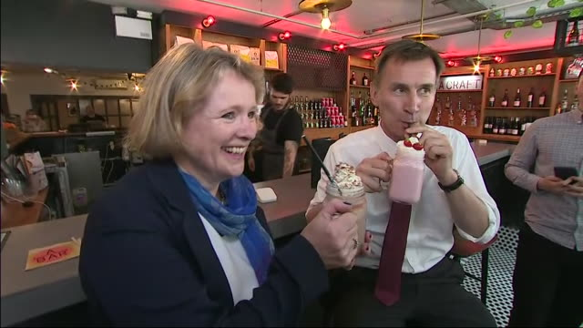 interior shots of british secretary of state for foreign affairs and conservative party leadership candidate jeremy hunt mp drinking a strawberry... - strawberry milkshake stock videos & royalty-free footage