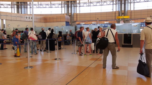 Interior shots of British tourists waiting in queues for passport control in Sharm el Sheikh airport in preparation for evacuation flights on...