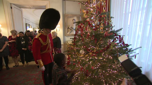 interior shots of camilla, duchess of cornwall and children attaching decorations to christmas tree inside clarence house on 13th december 2017... - royalty stock videos & royalty-free footage