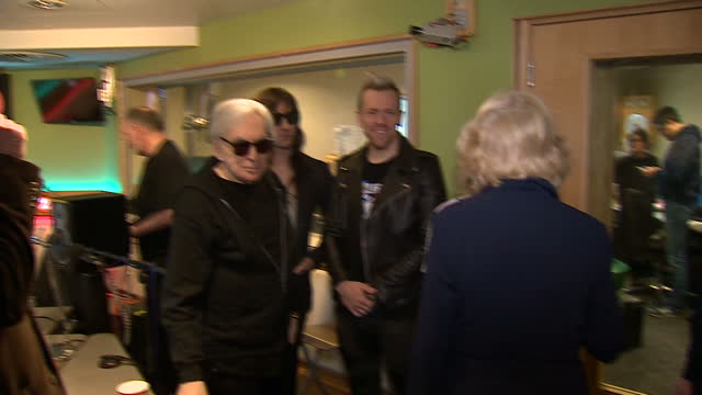 vídeos y material grabado en eventos de stock de interior shots of camilla, duchess of cornwall arriving at the bbc radio 2 studios, being greeted by chris evans and meeting members of the band... - bbc radio