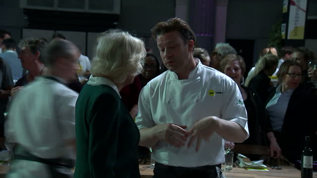 interior shots of camilla, duchess of cornwall, being introduced to various ceo's by chef jamie oliver at a ceo cook-off event on 21 march 2017 in... - jamie oliver stock videos & royalty-free footage