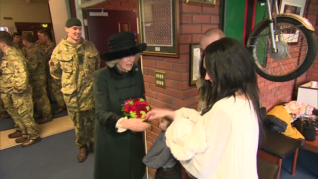 interior shots of camilla duchess of cornwall being presented with a bouquet of flowers by a young boy as she meets servicemen from the 4th batallion... - aldershot stock videos & royalty-free footage