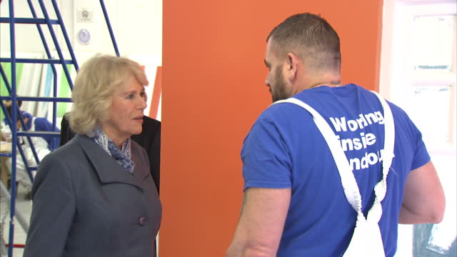 Interior shots of Camilla Duchess of Cornwall being shown round Brixton Prison and chatting to inmates inside painting and decorating workshop The...