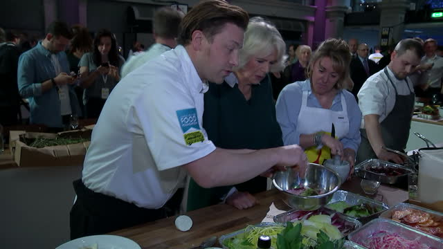 interior shots of camilla, duchess of cornwall, cooking with chef jamie oliver during a ceo cook-off event on 21 march 2017 in london, united kingdom - jamie oliver stock videos & royalty-free footage