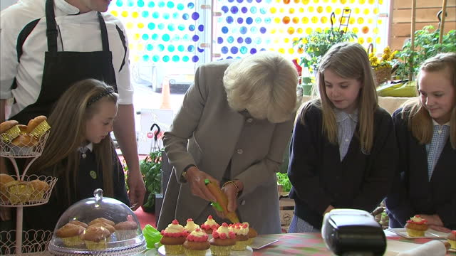 interior shots of Camilla Duchess of Cornwall decorating cup cake with children on her visit to the Skainos Centre on May 21 2015 in Belfast United...