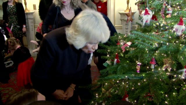Interior shots of Camilla Duchess of Cornwall helping children decorate Christmas Tree at Clarence House on December 15 2015 in London England