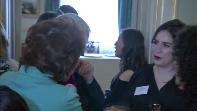 Interior shots of Camilla Duchess of Cornwall meeting various guests at a Women of the World event including Annie Lennox at Clarence House on 8...