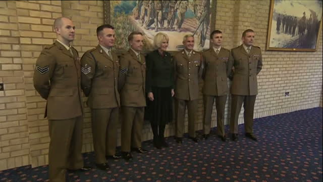 stockvideo's en b-roll-footage met interior shots of camilla duchess of cornwall posing for a group photograph with servicemen to whom she awarded medals during a visit to normandy... - aldershot