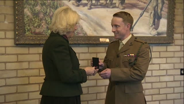 stockvideo's en b-roll-footage met interior shots of camilla duchess of cornwall presenting long service medals and a meritorious service medal to servicemen from the 4th battalion the... - aldershot