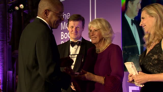 interior shots of camilla duchess of cornwall presenting the man booker prize to author paul beatty on october 25 2016 in london england - man booker prize stock videos & royalty-free footage