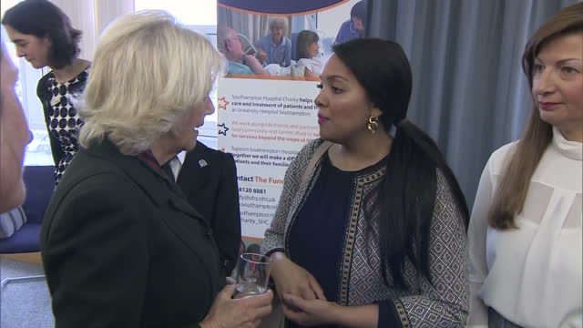 interior shots of camilla duchess of cornwall speaking to shelina permalloo, 2012 masterchef winner and champion of the southampton children's... - masterchef stock videos & royalty-free footage