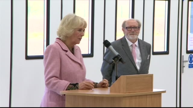 interior shots of camilla duchess of cornwall unveiling a plaque and making a speech marking the opening of a new air ambulance airbase on 14... - wiltshire stock videos & royalty-free footage