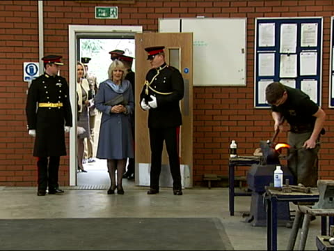 interior shots of camilla duchess of cornwall walk into stables and see men making welding hose shoes duchess of cornwall opens the kings troops... - see other clips from this shoot 15 stock videos and b-roll footage