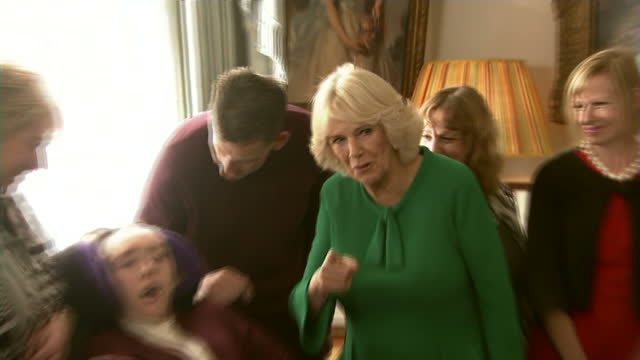 interior shots of camilla duchess of cornwall walking through clarence house and meet children from the helen and douglas house hospice in... - dahl stock videos and b-roll footage