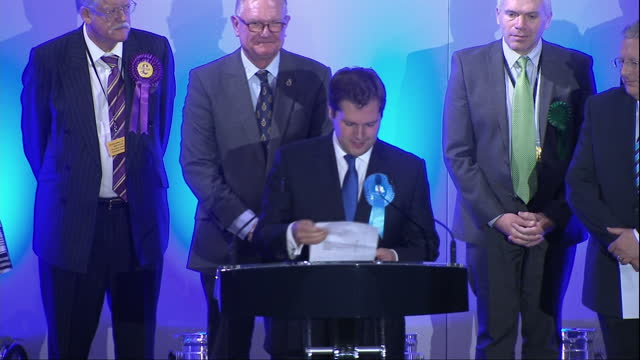 interior shots of candidates running in the newark by election stood on stage robert jenrick mp conservatives candidate approaching the podium to... - british liberal democratic party stock videos and b-roll footage