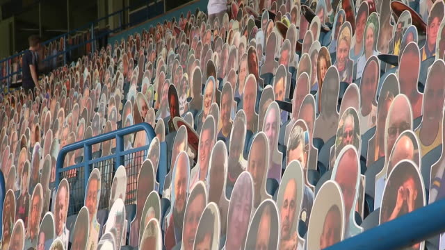 interior shots of cardboard cutouts of fans in the stands at elland road. - plain background stock videos & royalty-free footage