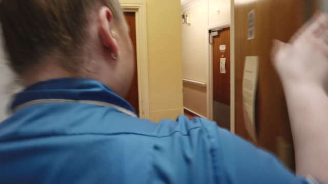 interior shots of care worker walking upstairs leading to the main floor of the care home, shots of care staff putting on ppe such as plastic aprons,... - care stock videos & royalty-free footage