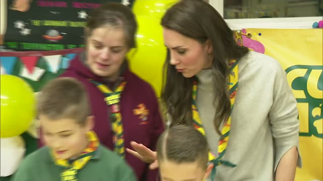 Interior shots of Catherine Duchess of Cambridge decorating cupcakes talking to children at a Cub Scout pack meeting on December 14 2016 in King's...