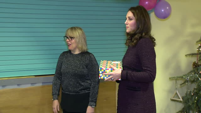 interior shots of catherine duchess of cambridge handing out presents to children during the rugby portobello trust's christmas party for one of its... - herzogin stock-videos und b-roll-filmmaterial