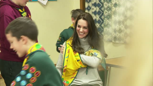interior shots of catherine duchess of cambridge helping cub scouts learn first aid and letting one cub put a sling around her arm at a cub scout... - cub scout stock videos and b-roll footage