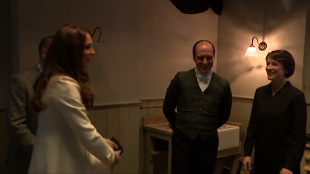 Interior shots of Catherine Duchess of Cambridge meeting Downton Abbey cast members during a tour of the servants quarters sets at Ealing Studios>>...