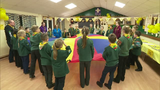 interior shots of catherine, duchess of cambridge playing game with cub scouts and running under a colourful parachute once her birthday month is... - 6 7 years stock videos & royalty-free footage