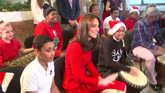 Interior shots of Catherine Duchess of Cambridge playing the bongo drums with children in the Anna Freud Centre at Anna Freud Centre on December 15...