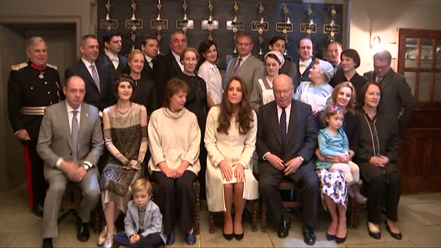 Interior shots of Catherine Duchess of Cambridge posing for a group photograph with members of the Downton Abbey cast and crew>> on March 12 2015 in...