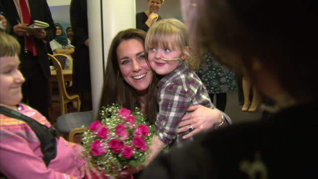 interior shots of catherine duchess of cambridge receiving a posy of flowers and being hugged by a little girl before departing after a visit to... - 2013 stock videos & royalty-free footage