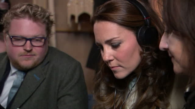 Interior shots of Catherine Duchess of Cambridge speaking to a member of the Downton Abbey production team and watching a scene being recorded on...